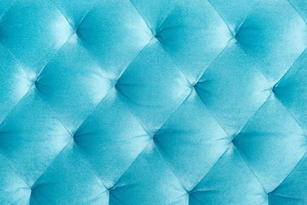 A veludo luxuoso acolchoou o estofamento do sofá, a textura home da decoração ou o fundo. design de móveis, interior clássico e conceito de material vintage real