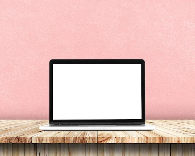 A vista dianteira do portátil está na tabela de trabalho, fundo colorido.