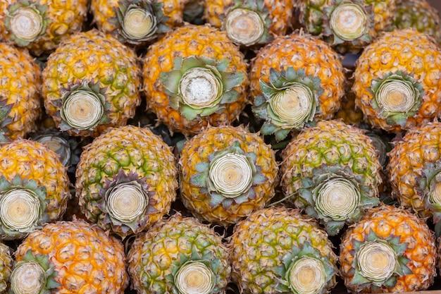 Abacaxi no mercado, fundo de abacaxi