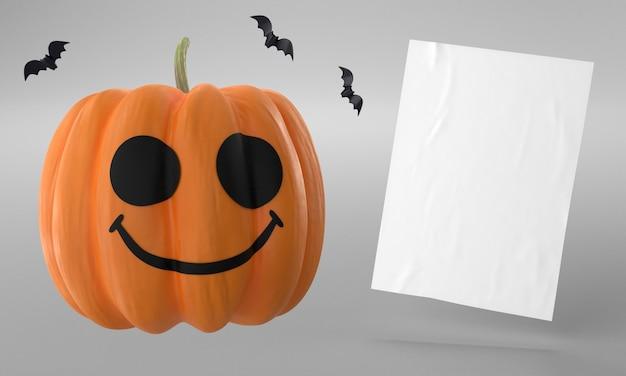 Abóbora e página de papel para o dia das bruxas