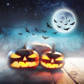 Abóboras de halloween em uma floresta mística à noite com lua cheia e morcegos