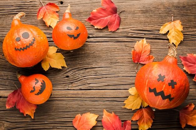 Abóboras e folhas de decoração de halloween