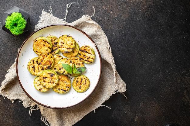 Abobrinha grelhada vegetal na mesa refeição saudável lanche cópia espaço comida fundo rústico