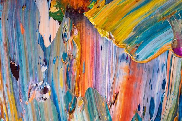 Abstração brilhante, suculenta, multi-colorida de sua mistura de pinturas de óleo em um close-up da paleta.