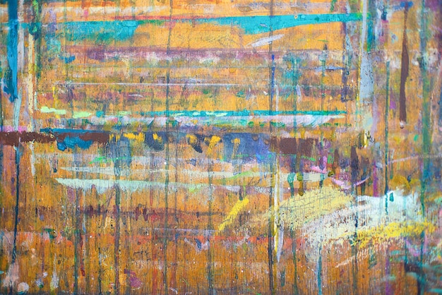 Abstração colorida. textura, pintura de fundo com tintas coloridas em fundo de madeira
