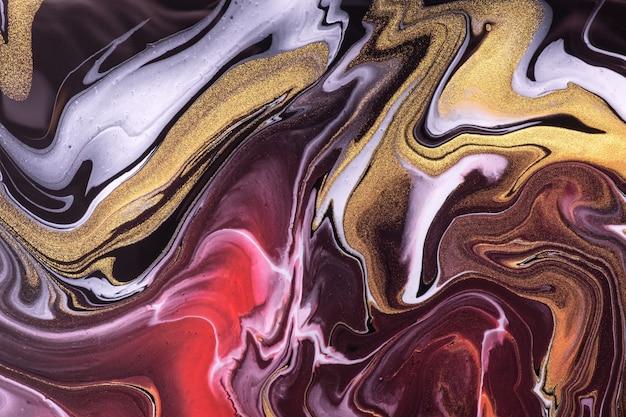 Abstrato arte fluida fundo escuro cores vermelho e dourado. mármore líquido. pintura acrílica sobre tela com linhas roxas e gradiente. cenário de tinta a álcool com padrão preto ondulado.