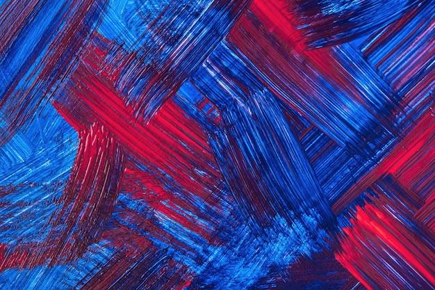 Abstrato arte fundo vermelho escuro e cores azuis marinhas. pintura em aquarela sobre tela com pinceladas de safira e respingos. arte em acrílico sobre papel com padrão de pinceladas. pano de fundo de textura.