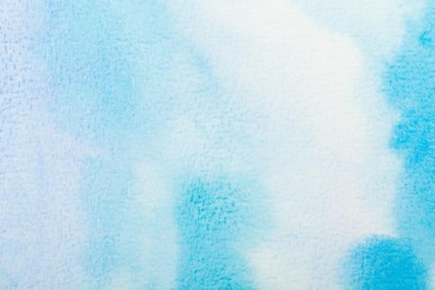 Abstrato azul aquarela. cor espirrando no papel. desenhado à mão.