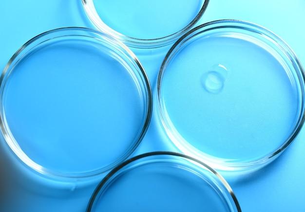 Abstrato base de cosmetologia médica azul de placas de petri de vidro