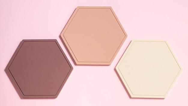 Abstrato base plana leiga com figura de favos de mel pastel. pano de fundo flatlay criativo. idéia criativa, layout.