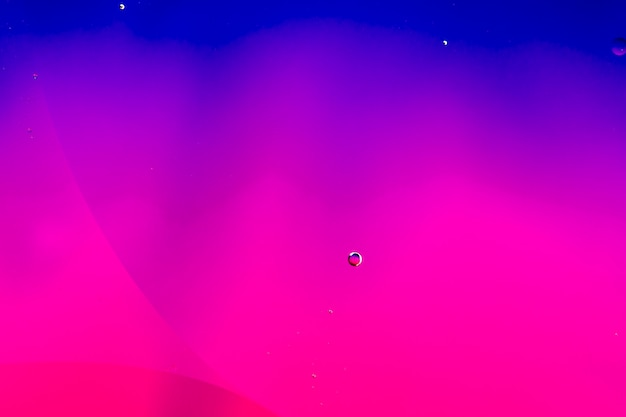 Abstrato colorido cenário em óleo e ondas na superfície da água