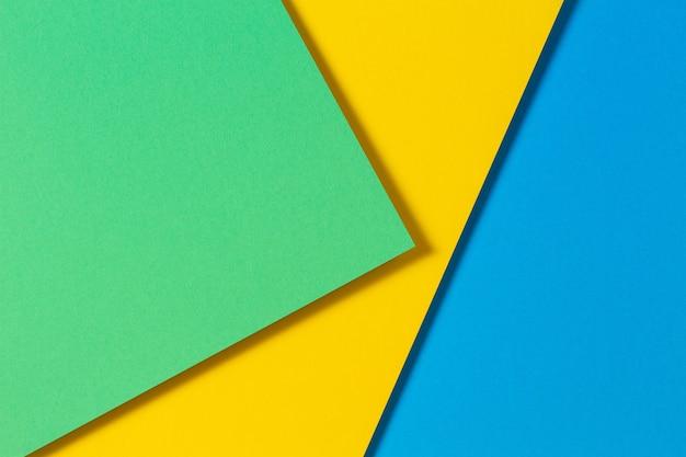 Abstrato cor papéis geometria plana leigos composição fundo com tons de cor azul amarelo e verde