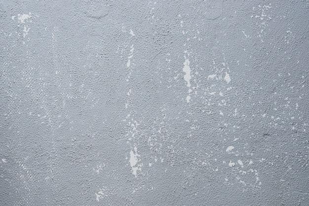 Abstrato de cinza velho pintado na parede de concreto com tex riscado e aflição