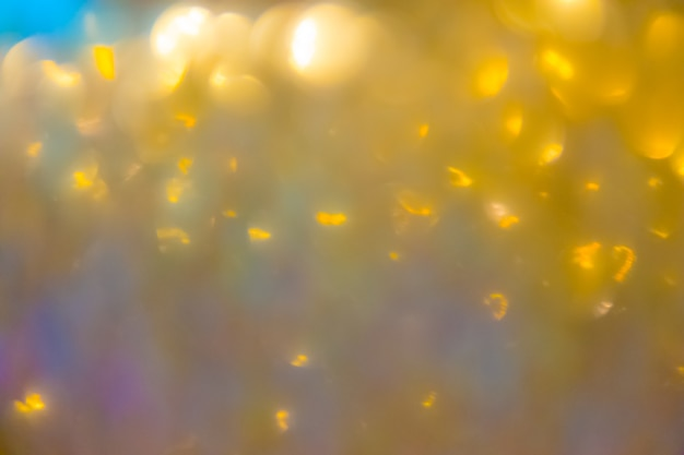 Abstrato de natal com luzes desfocado bokeh de ouro