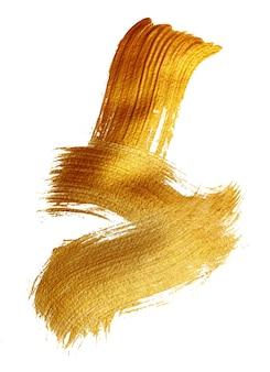 Abstrato dourado com pincel de tinta acrílica em fundo branco