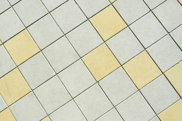 Abstrato e textura de um azulejo quadrado de rua