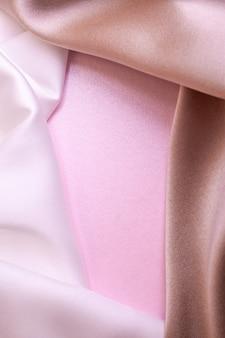 Abstrato em cores suaves de tecidos de seda em papel pérola rosa. bela textura de tendência.