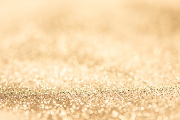 Abstrato turva fundo de bokeh ouro cintilante.