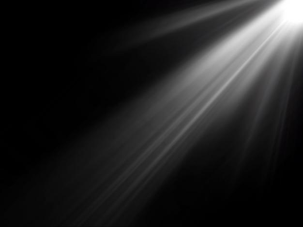 Abstratos belos raios de luz sobre fundo preto.