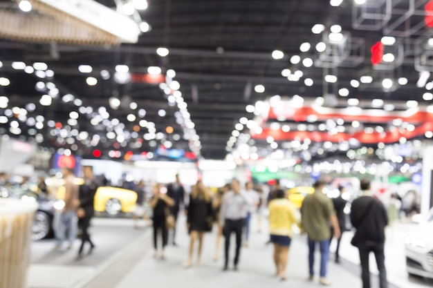Abtract borrão pessoas no salão de exposições motor show evento fundo