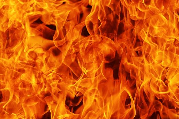 Acendendo fundo de chamas de fogo e resumo, detalhe de fogo