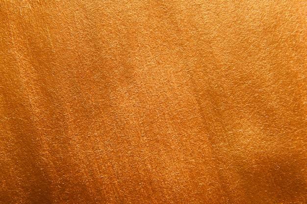 Acrílico dourado pintado fundo de textura. superfície decorativa.
