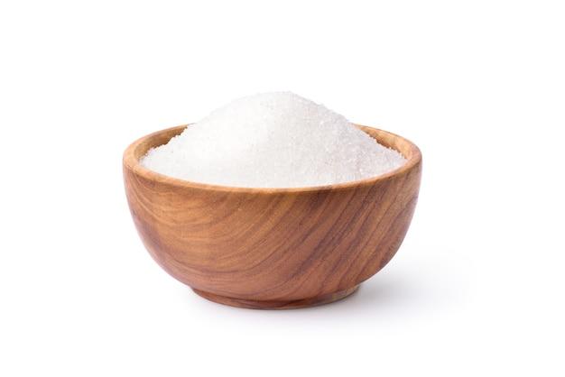 Açúcar de cana em tigela de madeira