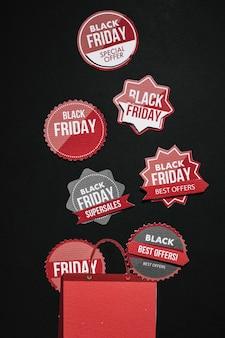 Adesivos de sexta-feira negra e saco de papel vermelho