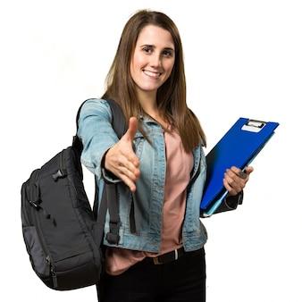 Adolescente, estudante, menina, segurando, livros, fazer, negócio