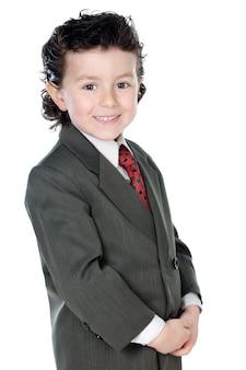 Adorável criança com roupas elegantes um fundo branco