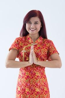 Adorável menina chinesa, desejando-lhe