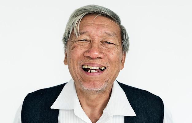 Adulto sênior worldface-tailandês em um fundo branco