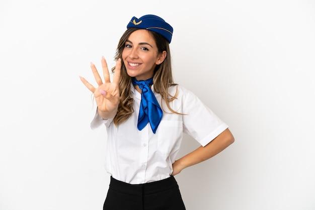 Aeromoça de avião sobre fundo branco isolado feliz e contando quatro com os dedos