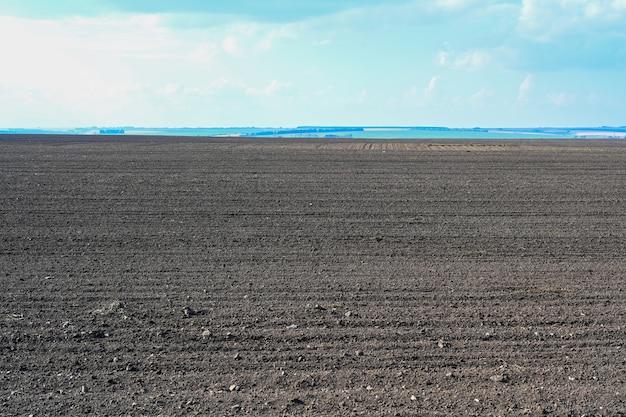 Agricultura campo arado solo preto campo arado arado solo preparado para plantio de safra