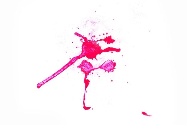 Água vermelha da mistura da cor do pó no livro branco.
