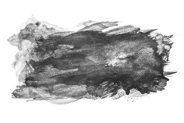 Aguarela preta que espirra no fundo branco, pintura da mão no papel.