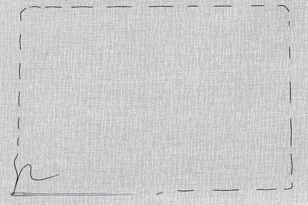 Agulha e linha em textura de linho natural como borda com espaço livre para seu texto