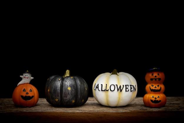 Ainda abóbora de dia das bruxas da vida no fundo preto. conceito de halloween