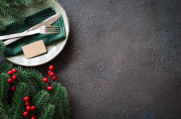Ajuste festivo da tabela do natal com espaço da cópia.