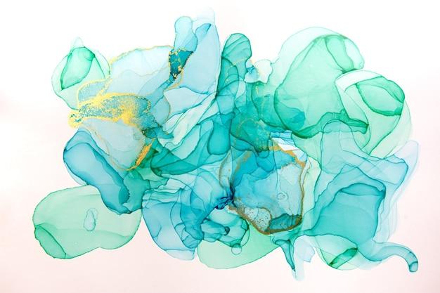Álcool tinta azul e fundo abstrato dourado. textura em aquarela de estilo oceano.