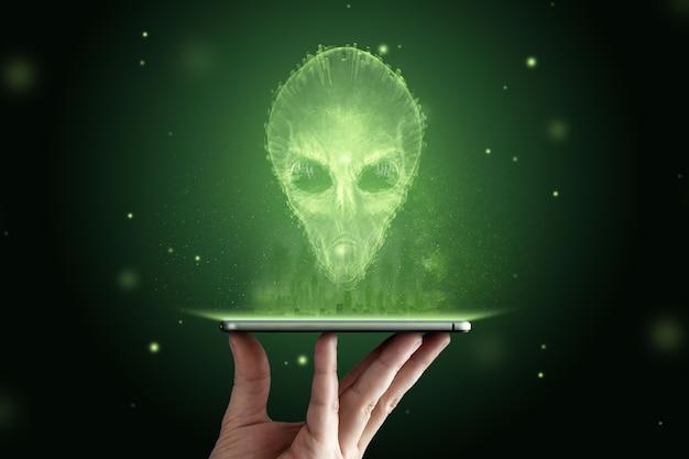 Alienígena de cabeça verde com grandes olhos de vidro pretos. conceito de ovnis, alienígenas, contato com a civilização extraterrestre.