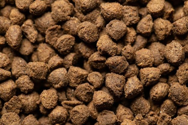 Alimento natural seco e balanceado para gatos em granulado vista de cima, close-up