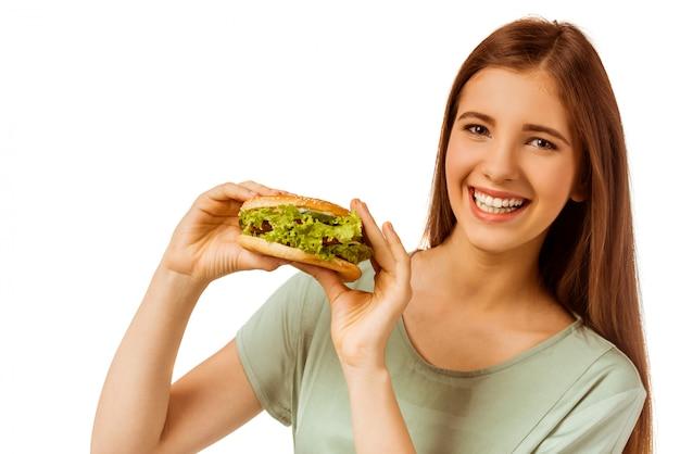Alimento saudável para a rapariga que que come o sanduíche.