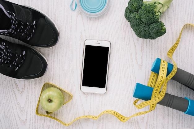 Alimentos saudáveis e equipamentos de esporte