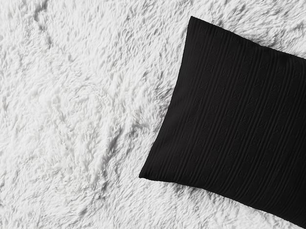 Almofada preta almofada em manta xadrez branca e fofa como vista de cima do quarto plano de fundo e ...