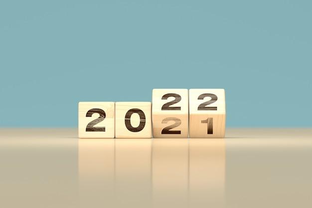 Alterar 2021 para 2022 conceito de feliz ano novo - cubos de madeira - renderização 3d