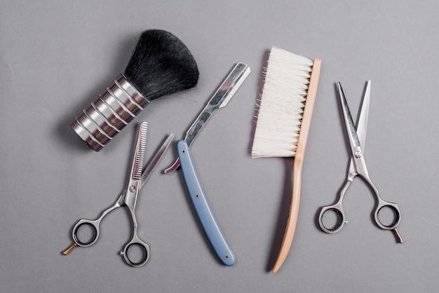 Alto, ângulo, vista, vários, barbeiro, ferramentas, cinzento, fundo