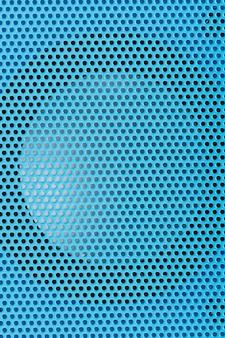 Alto-falante acústico com malha azul. plano de fundo para o design