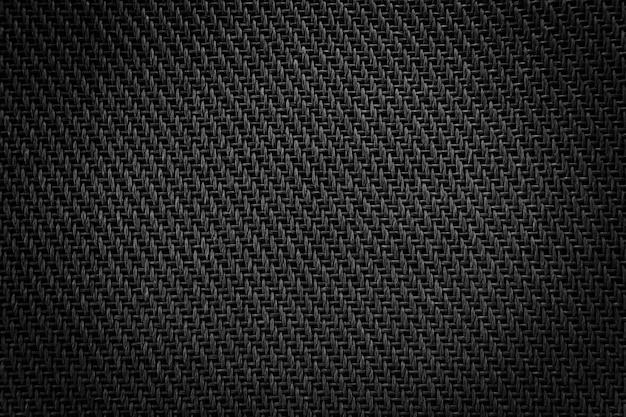 Alto-falante de pano de malha detalhe de tecido preto do amplificador.