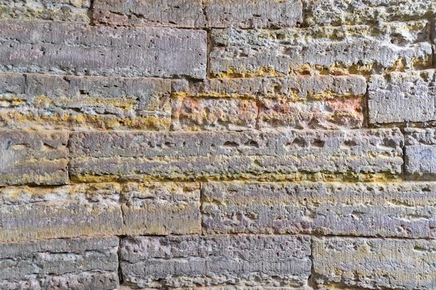 Alvenaria do século xviii. fundo abstrato de tijolos vintage.